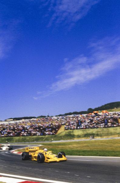 Satoru Nakajima, Lotus 99T Honda, leads Derek Warwick, Arrows A10 Megatron.