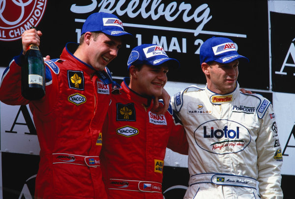 2002 F3000 ChampionshipA1-Ring, Austria. 11th May 2002.Race podium - Tomas Enge, 1st, Arden team mate, Bjorn Wirdheim, 2nd, and Mario Haberfeld 3rd.World Copyright: Clive Rose/LAT Photographicref: 35mm Image A09