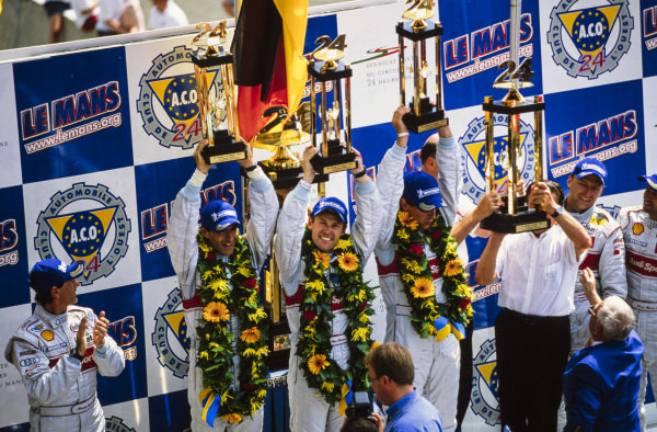 Winners Frank Biela, Emanuele Pirro & Tom Kristensen celebrate on the podium.