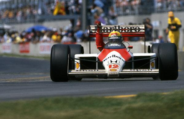 Race winner Ayrton Senna (BRA) McLaren MP4/4 at Formula One World Championship, Rd5, Canadian Grand Prix, Montreal, Canada, 12 June 1988.