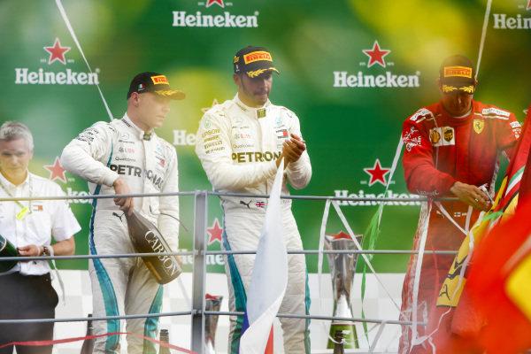Valtteri Bottas, Mercedes AMG F1, 3rd position, Lewis Hamilton, Mercedes AMG F1, 1st position, and Kimi Raikkonen, Ferrari, 2nd position, celebrate on the podium.