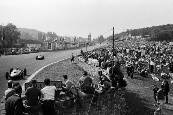 Ricardo Rodriguez, Ferrari 156, leads Phil Hill, Ferrari 156, into Eau Rouge.