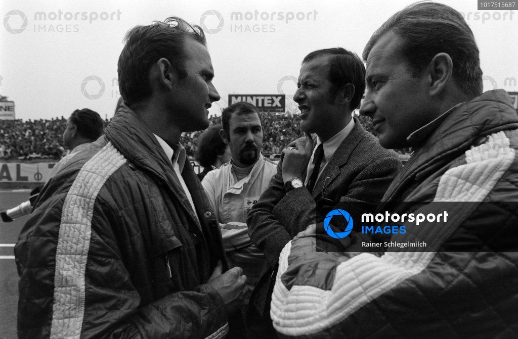 Willy Kauhsen waits in the pits behind Porsche Designer, Ferdinard Piech and Porsche press officer, Rico Steinemann in the suit.