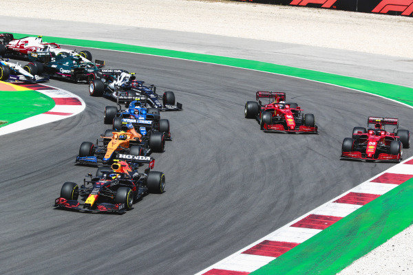Sergio Perez, Red Bull Racing RB16B, leads Lando Norris, McLaren MCL35M, Esteban Ocon, Alpine A521, Carlos Sainz, Ferrari SF21, Charles Leclerc, Ferrari SF21, and Pierre Gasly, AlphaTauri AT02, at the restart