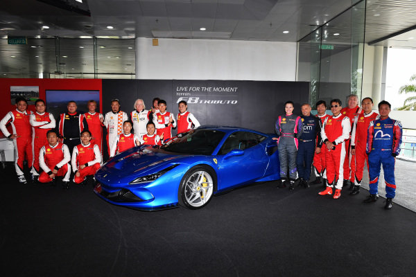 Drivers pose with the Ferrari F8 Tributo