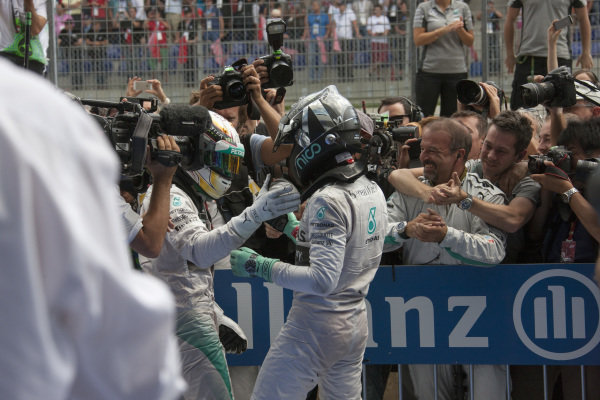 Lewis Hamilton, 2nd position, congratulates race winner Nico Rosberg in parc ferme.