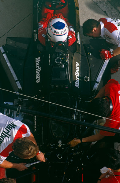 Jerez, Spain. 29/9-1/10 1989. Overhead view of mechanics working on the McLaren MP4/5 and Honda RA101E V10 engine as Alain Prost sits in the cockpit. Ref: 89 ESP 03. World Copyright - LAT Photographic