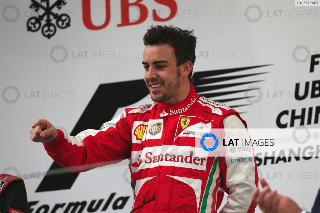 Shanghai International Circuit, Shanghai, China Sunday 14th April 2013 Fernando Alonso, Ferrari, 1st position, celebrates on the podium. World Copyright: Andy Hone/LAT Photographic ref: Digital Image HONZ7853
