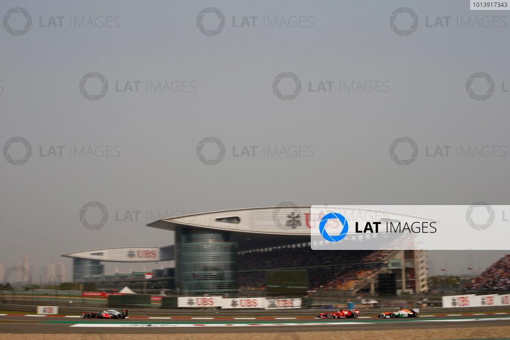 Shanghai International Circuit, Shanghai, China Sunday 14th April 2013 Sergio Perez, McLaren MP4-28 Mercedes, leads Fernando Alonso, Ferrari F138, and Paul di Resta, Force India VJM06 Mercedes.  World Copyright: Glenn Dunbar/LAT Photographic ref: Digital Image _89P8282