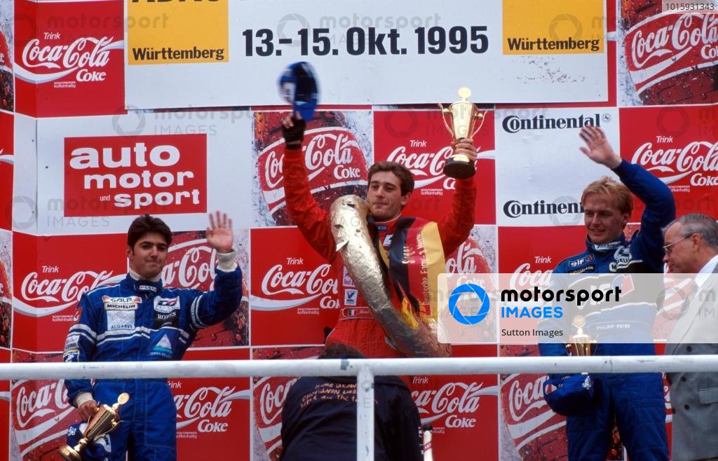 The podium for the final race of the season (l to r): Rui Aguas (POR) second; Jarno Trulli (ITA) winner; Philipp Peter (AUT) third.German Formula Three Championship, Hockenheim, Germany, 15 October 1995.