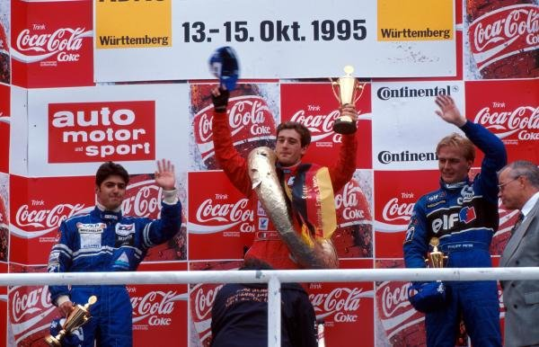 The podium for the final race of the season (l to r): Rui Aguas (POR) second; Jarno Trulli (ITA) winner; Philipp Peter (AUT) third.German Formula Three Championship, Hockenheim, Germany, 15 October 1995.