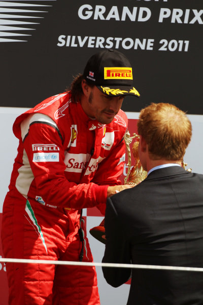 Race winner Fernando Alonso (ESP) Ferrari is presented with his trophy by HRH Prince Harry (GBR). Formula One World Championship, Rd 9, British Grand Prix, Race, Silverstone, England, Sunday 10 July 2011.  BEST IMAGE