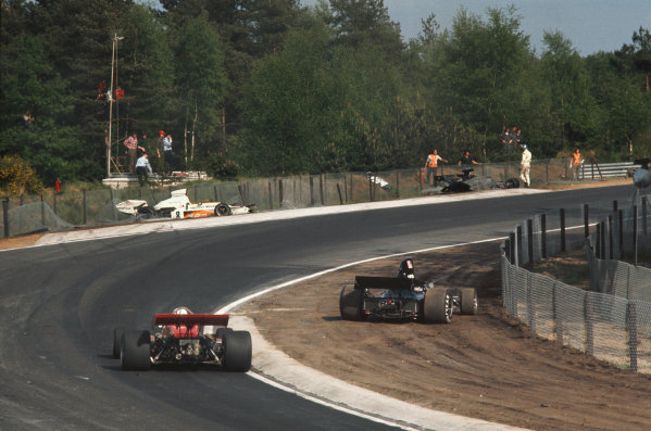 1973 Belgian Grand Prix.  Zolder, Belgium. 18-20th May 1973.  Ronnie Peterson steps away from his Lotus 72E Ford entangled in the catch fencing as Chris Amon, Tecno PA123B, passes a stricken Shadow DN1 Ford and Peter Revson's McLaren M23 Ford.  Ref: 73BEL85. World Copyright: LAT Photographic