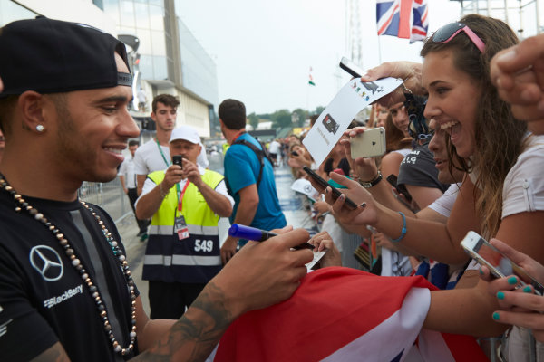 Hungaroring, Budapest, Hungary. Thursday 23 July 2015. Lewis Hamilton, Mercedes AMG, signs autographs for fans. World Copyright: Steve Etherington/LAT Photographic ref: Digital Image SNE11297