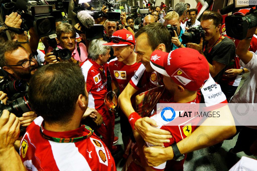 Marina Bay Circuit, Singapore. Sunday 20 September 2015. Sebastian Vettel, Ferrari, 1st Position, Kimi Raikkonen, Ferrari, 3rd Position, and the Ferrari team celebrate a double podium result. World Copyright: Alastair Staley/LAT Photographic ref: Digital Image _R6T7589
