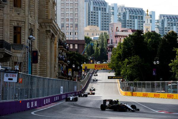 Baku City Circuit, Baku, Azerbaijan. Sunday 19 June 2016. Sergio Perez, Force India VJM09 Mercedes, leads Felipe Massa, Williams FW38 Mercedes at the start of the race World Copyright: Sam Bloxham/LAT Photographic ref: Digital Image _SLA3489