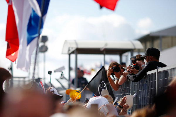 Hungaroring, Budapest, Hungary.  Thursday 27 July 2017. Lewis Hamilton, Mercedes AMG, is photographed signing autographs for fans. World Copyright: Andy Hone/LAT Images  ref: Digital Image _ONZ7983