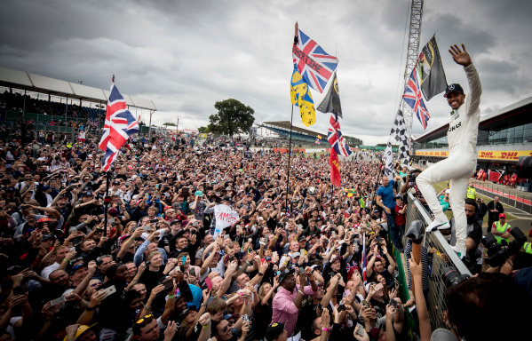 Silverstone, Northamptonshire, UK.  Sunday 16 July 2017. Lewis Hamilton, Mercedes AMG, 1st Position, celebrates victory with the British fans. World Copyright: Dunbar/LAT Images  ref: Digital Image _X4I8659