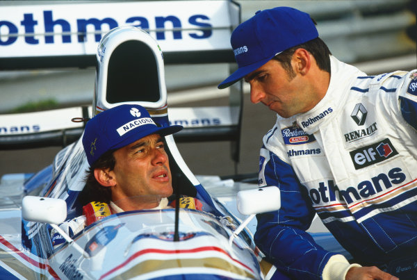 Estoril, Portugal. Damon Hill and Ayrton Senna (Rothmans Williams FW16-Renault), pose for the World`s press portrait.  World Copyright: LAT Photographic. Ref: Digital Image Only.