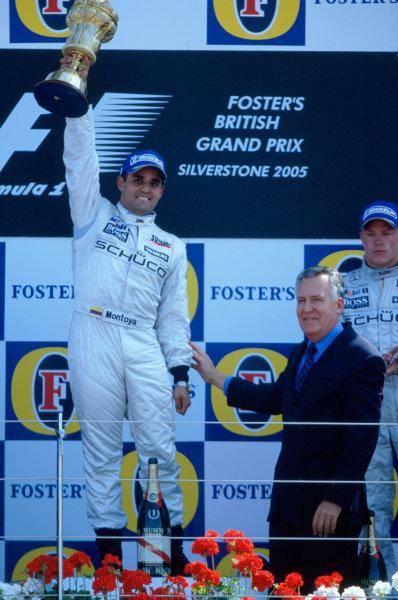 2005 British Grand Prix. Silverstone, England. 8th - 10th July 2005 Juan Pablo Montoya, McLaren Mercedes MP4-20 celebrates winning the British Grand Prix World Copyright: Peter Spinney/LAT Photographic Ref: 35mm Image A01