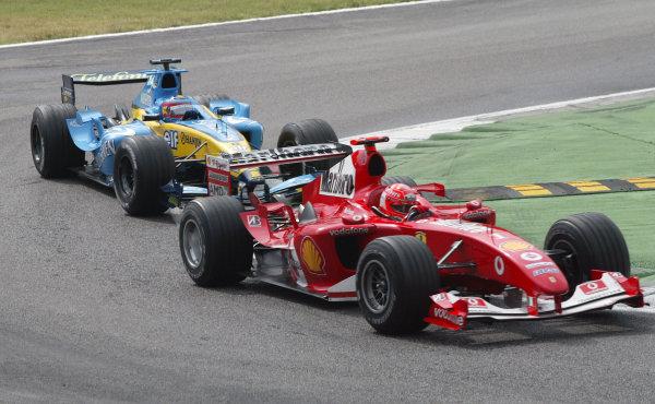 2004 Italian Grand Prix - Sunday Race, Monza, Italy. 12th September 2004 Michael Schumacher, Ferrari F2004, leads Fernando Alonso, Renault R24, action.World Copyright: Steve Etherington/LAT Photographic ref: Digital Image Only