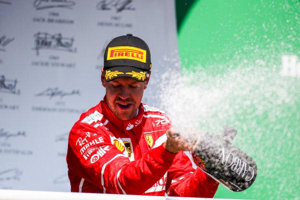 Interlagos, Sao Paulo, Brazil. Sunday 12 November 2017. Sebastian Vettel, Ferrari, 1st Position, sprays Champagne from the podium. World Copyright: Charles Coates/LAT Images  ref: Digital Image AN7T7175