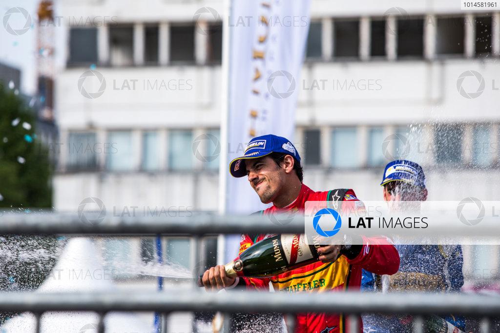 2015/2016 FIA Formula E Championship. Berlin ePrix, Berlin, Germany. Saturday 21 May 2016. Lucas Di Grassi (BRA), ABT Audi Sport FE01 and Sebastien Buemi (SUI), Renault e.Dams Z.E.15 on the podium. Photo: Zak Mauger/LAT/Formula E ref: Digital Image _L0U2554