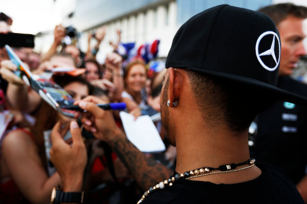 Hungaroring, Budapest, Hungary. Thursday 23 July 2015. Lewis Hamilton, Mercedes AMG, signs autographs for fans. World Copyright: Charles Coates/LAT Photographic ref: Digital Image _N7T1798