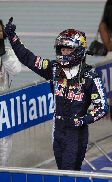 Yas Marina Circuit, Abu Dhabi, United Arab Emirates 1st November 2009. Sebastian Vettel, Red Bull Racing RB5 Renault, 1st position, and celebrates in Parc Ferme. Portrait. Helmets. Finish. World Copyright: Steve Etherington/LAT Photographic ref: Digital Image SNE17902