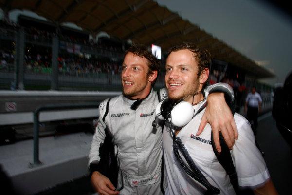 Sepang, Kuala Lumpur, Malaysia5th April 2009Jenson Button, Brawn GP BGP001 Mercedes, 1st position, celebrates with a Brawn GP team member. Portrait. World Copyright: Charles Coates/LAT Photographicref: Digital Image _26Y8936