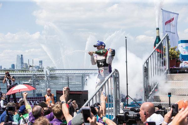 2016/2017 FIA Formula E Championship. Round 10 - New York City ePrix, Brooklyn, New York, USA. Sunday 16 July 2017. Winner Sam Bird (GBR), DS Virgin Racing, Spark-Citroen, Virgin DSV-02, celebrates on the podium as he sprays the champagne. Photo: Andrew Ferraro/LAT/Formula E ref: Digital Image _FER9947