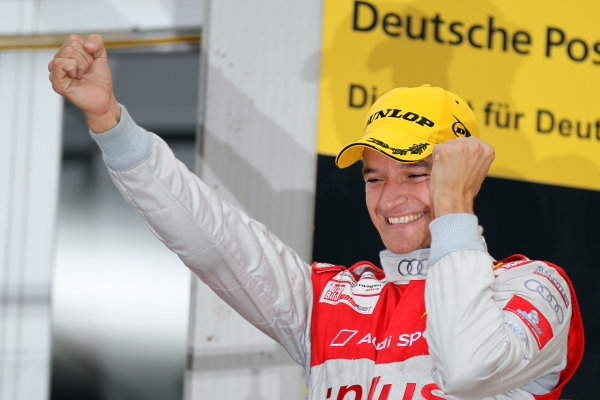 Race winner Timo Scheider (GER), Audi Sport Team Abt celebrates on the podium.DTM, Rd10, Adria International Raceway, Italy. 29-31 October 2010 World Copyright: LAT Photographicref: dne1031oc128