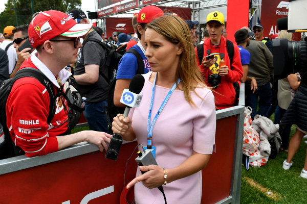 A member of the press talks to a fan