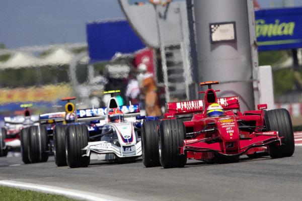 Felipe Massa, Ferrari F2007 waits ahead of Robert Kubica, BMW Sauber F1.07 for the green light to go qualifying.