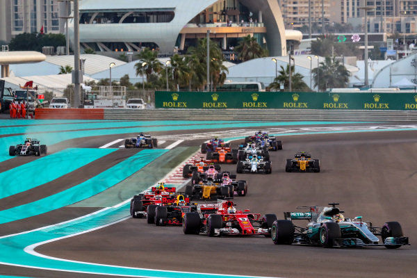 Lewis Hamilton (GBR) Mercedes-Benz F1 W08 Hybrid battles for position and Kevin Magnussen (DEN) Haas VF-17 runs wide at the start of the race at Formula One World Championship, Rd20, Abu Dhabi Grand Prix, Race, Yas Marina Circuit, Abu Dhabi, UAE, Sunday 26 November 2017.