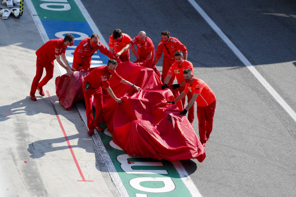 Car of Charles Leclerc, Ferrari SF1000 being returned to the garage by Ferrari Mechanics