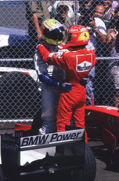 2001 Canadian Grand PrixMontreal, Canada. 8th-10th June 2001Race winner. Ralf Schumacher, BMW Williams FW23, celebrates with brother Michael Schumacher, Ferrari F2001 (2nd).World Copyright: LAT Photographicref: 35mm Image A21