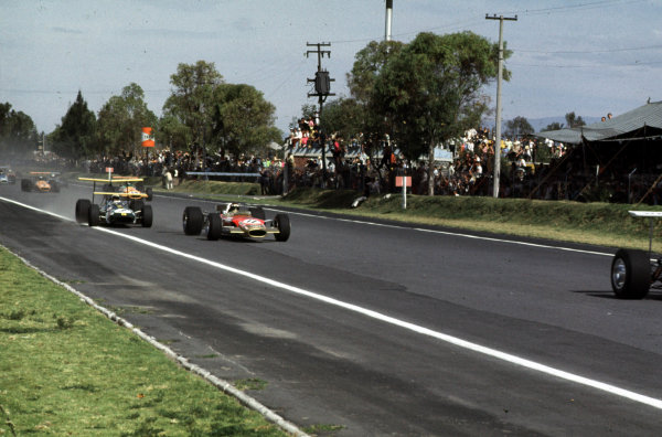 1968 Mexican Grand Prix.Mexico City, Mexico.1-3 November 1968.Jo Siffert leads Jackie Oliver (both Lotus 49B Ford) and Jack Brabham (Brabham BT26 Repco). They finished in 6th, 3rd and 10th positions respectively.Ref-68 MEX 14.World Copyright - LAT Photographic