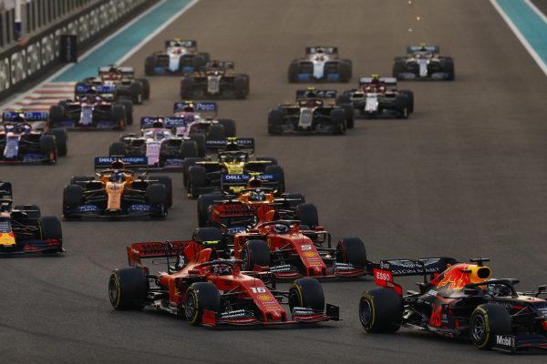 Max Verstappen, Red Bull Racing RB15, leads Charles Leclerc, Ferrari SF90, Sebastian Vettel, Ferrari SF90, Lando Norris, McLaren MCL34, Alexander Albon, Red Bull RB15, Carlos Sainz Jr., McLaren MCL34 and the rest of the pack