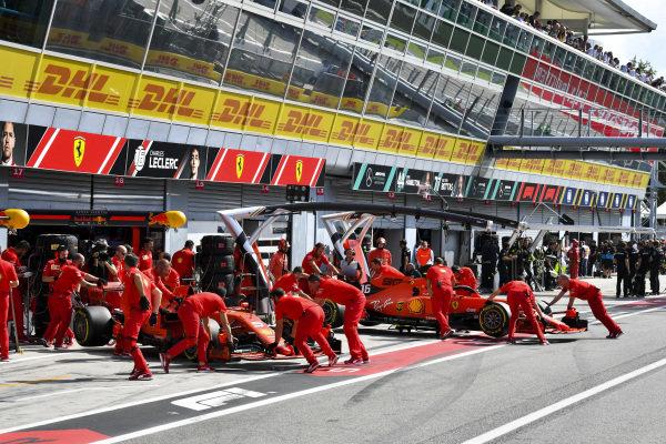 Sebastian Vettel, Ferrari SF90 and Charles Leclerc, Ferrari SF90 being pushed into the Ferrari garage