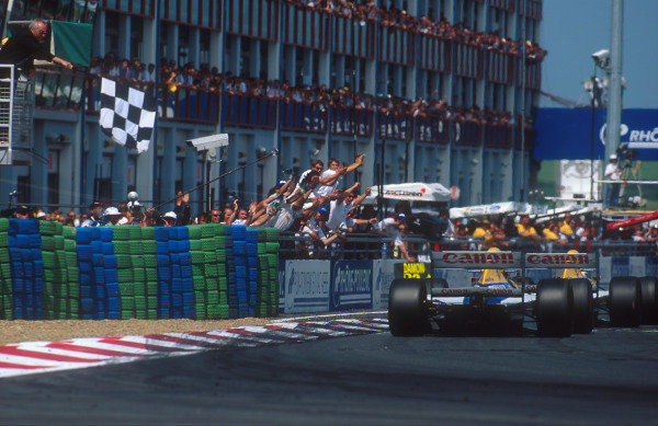 1993 French Grand Prix.Magny-Cours, France.2-4 July 1993.Alain Prost (Williams FW15C Renault) takes the chequered flag for 1st position just ahead of teammate Damon Hill (Williams FW15C Renault) 2nd position.Ref-93 FRA 05.World Copyright - LAT Photographic