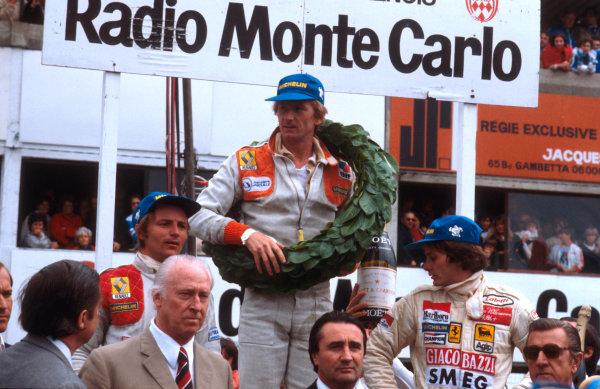 1979 French Grand Prix.Dijon-Prenois, France.29/6-1/7 1979.Jean-Pierre Jabouille (Equipe Renault) 1st position, Gilles Villeneuve (Ferrari) 2nd position and Rene Arnoux (Equipe Renault) 3rd position on the podium.Ref-79 FRA 05.World Copyright - LAT Photographic