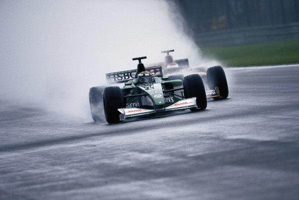 Eddie Irvine, Jaguar R1 Cosworth, leads Jos Verstappen, Arrows A21 Supertec.