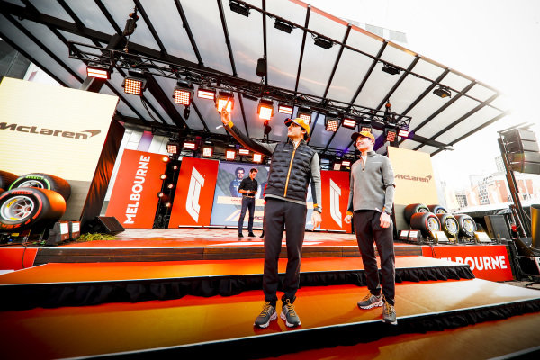 Carlos Sainz Jr, McLaren and Lando Norris, McLaren take a selfie on stage at the Federation Square event.