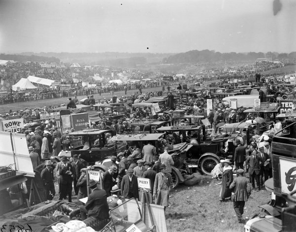 Bookmakers stands amongst crowds and vehicles at the Epsom Derby