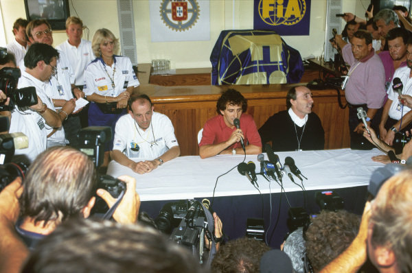 1992 Portuguese Grand Prix. Estoril, Portugal. 25-27 September 1992. Alain Prost announces his return to F1 with the Williams Renault team for 1993 season. Pictured at the press conference with Renault Sport Managing Director, Christian Contzen and Team Manager, Frank Williams, portrait.  World Copyright: LAT Photographic.