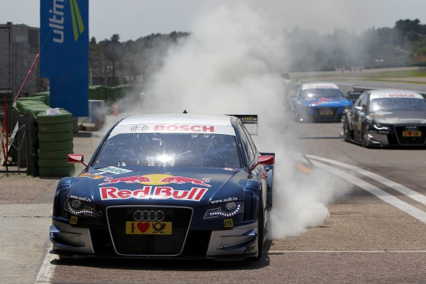 Race winner Mattias Ekstrom (SWE), Audi Sport Team Abt Sportsline, Red Bull Audi A4 DTM (2009) celebrates his victory with a burnout.