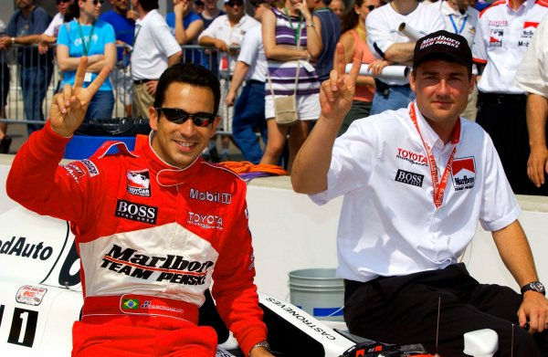 Week one of practice for the 87th Indianapolis 500, Indianapolis Motor Speedway, Speedway, Indiana, USA 25 May,2003 Helio Castroneves and Team Penske manager Tim Cindric hold up two fingers for their back-to-back wins in the 500.World Copyright-F Peirce Williams 2003 LAT Photographicref: Digital Image Only