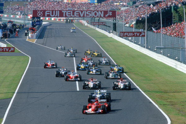 2004 Japanese Grand Prix.Suzuka , Japan 8th - 10th October 2004Michael Schumacher, Ferrari F2004 leads the field into the first corner at the start of the race. Action. World Copyright:Lorenzo Bellanca/LAT Photographic ref: 35mm Image: Ax07