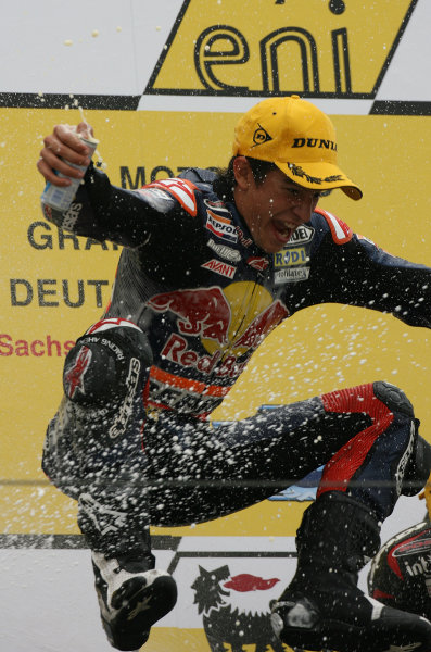 Germany Sachsenring 16-18 July 2010Marc Marquez Red Bull Ajo Derbi jumps for joy on the podium